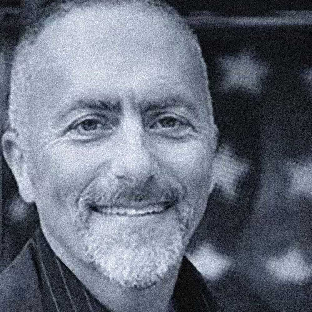 blue monochrome photo of man smiling