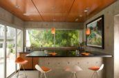 Clarke Residence building interior kitchen with orange stools